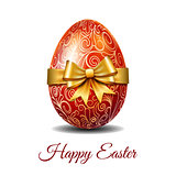Red Easter egg tied of gold ribbon