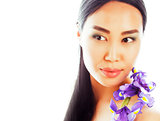 young pretty asian woman with flower orchid close up isolated sp
