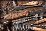 Old vintage kitchen items on a wooden background