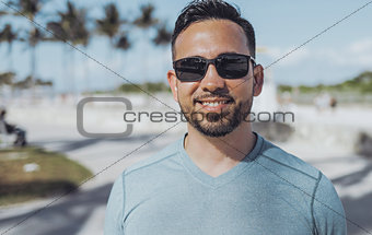 Casual young man in sunglasses