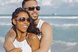 Embracing stylish couple on ocean shore