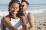 Pretty black girl with boyfriend on beach