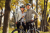 backlight photo of a couple having fun by bike