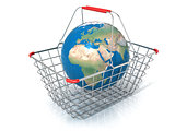 Globe in steel wire shopping basket isolated