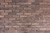 Texture of the old closeup brown brick wall