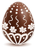 Chocolate sweet decorated with white icing egg symbol Easter present