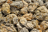 Big stones under metal wire