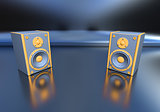 orange music speakers on blue background
