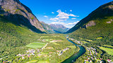 Norway in summer. Country town, river and mountains natural landscape aerial drone photography