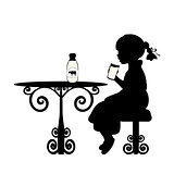 Silhouette girl is drinking milk