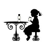 Silhouette girl is drinking milk