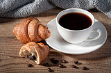 Black coffee with croissants