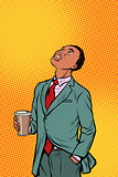 African businessman drinking coffee and looking up