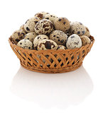quail eggs in a wicker basket on a white background, isolate