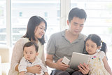 Asian family using tablet and smart phone