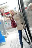 Senior Woman happy taking tram