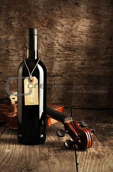 Red wine bottle and violin