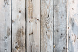 Old wooden vertical planks texture with scratches and cracks.
