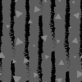 Dark triangles confetti seamless pattern on stripe background