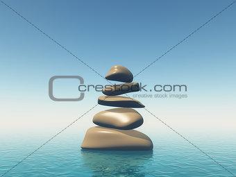 3D balancing pebbles in blue ocean