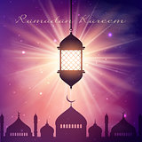 Ramadan Kareem background with hanging lantern and mosque silhou