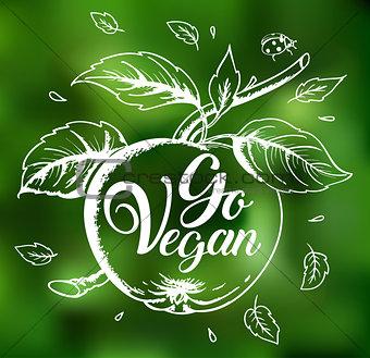 Apple and lettering Go vegan