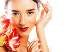 young pretty brunette woman with red flower amaryllis close up i