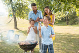 Portrait of happy family with two children outdoors