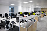 Empty open plan office with multiple work stations