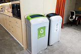 Recycling bins in a modern office kitchen