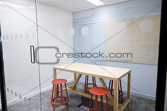 Small empty meeting room at a modern business premises