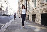 Woman walking in the street, full length
