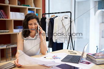 Female creative working on the phone in an office, close up