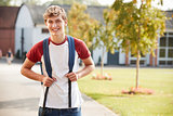 Portrait Of Male Teenage Student Walking Around College Campus
