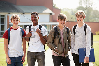 Portrait Of Male Teenage Students Walking Around College Campus