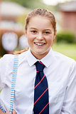 Portrait Of Female Teenage Student In Uniform Outside Buildings