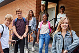 Portrait Of Teenage Students Outside School Building