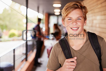 Portrait Of Male Teenage Student On College With Friends