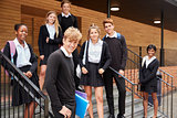 Portrait Of Teenage Students In Uniform Outside School Building