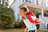 Young Boy Leaving House To Walk To School