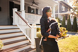Businesswoman With Baby Son Leaving House For Work