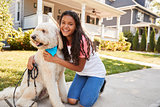 Portrait Of Girl With Dog On Suburban Street
