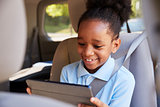 Boy Using Digital Tablet On Car Journey