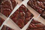 Display Of Freshly Baked Raspberry Swirl Brownies In Coffee Shop
