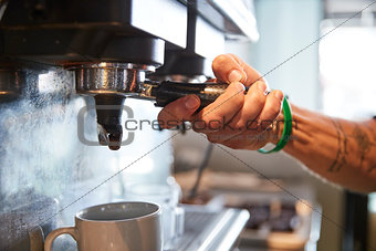 Close Up Of Male Barista Using Coffee Machine In Cafe