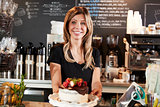 Waitress Holding Freshly Baked Cake With Buttercream Frosting
