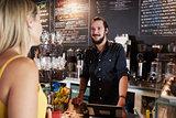 Waiter Taking Female Customer's Order In Coffee Shop