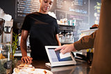 Customer Paying In Coffee Shop Using Credit Card