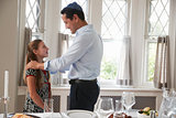 Jewish man standing with daughter before Shabbat meal