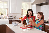 Jewish mother and daughter preparing dough for challah bread